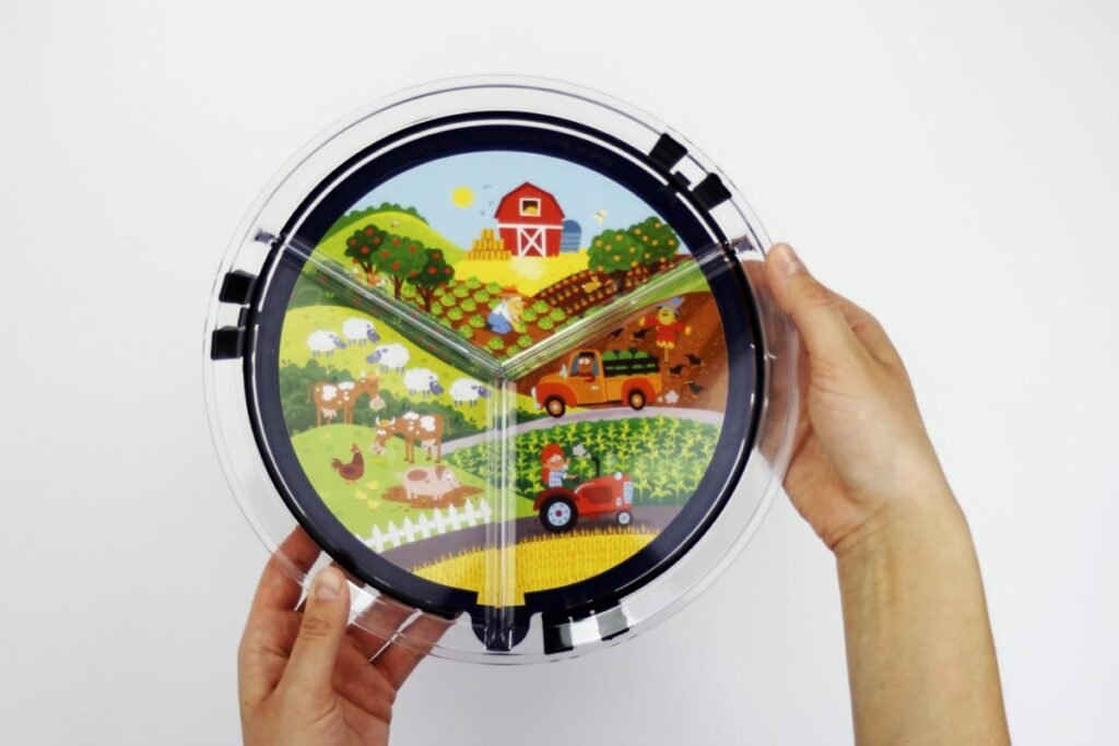 clear round plate with farm illustration card underneath plastic