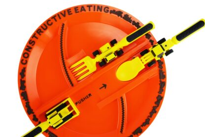 round orange plate with yellow construction utensils