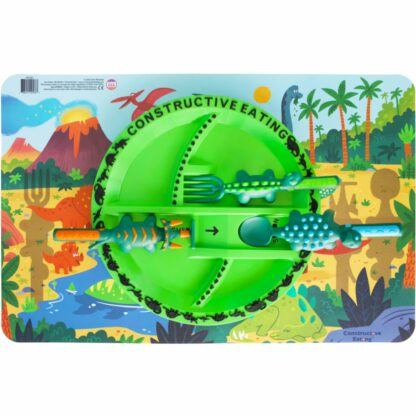 round green plate with dinosaur shaped utensils on an illustrated dinosaur scene placemat