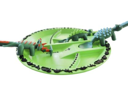 round green plate with dinosaur shaped utensils